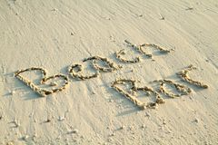 'Beach Bar' written in sand. Stock Image