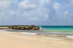 A Beach on Barbados. A photograph of rocks on a beach, on the caribbean island of Barbados Royalty Free Stock Image