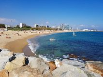 Beach in Barcelona with blue sea and rocks stock photo