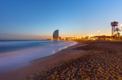 Beach in Barcelona at sunset Stock Photos