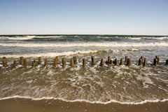Beach with barriers royalty free stock images