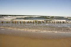 Beach with barriers stock images