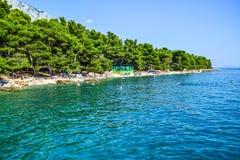 Beach in Baska Polje, Croatia. Baska Pole, Croatia - July 12, 2018: Vacationers on the public beach Baska Pole stock image