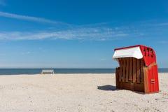 Beach basket, beach, sea, Langeoog. Beach baskets on a sandy beach with blue sky, on the island of Langeoog Royalty Free Stock Photos