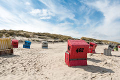 Beach basket, beach, sea, Langeoog. Beach baskets on a sandy beach with blue sky, on the island of Langeoog Stock Photo