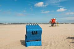 Beach basket, beach, sea, Langeoog. Beach baskets on a sandy beach with blue sky, on the island of Langeoog Stock Photos