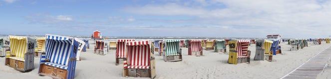 Beach basket, beach, sea, Langeoog. Beach baskets on a sandy beach with blue sky, on the island of Langeoog Stock Image