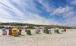 Beach basket, beach, sea, Langeoog. Beach baskets on a sandy beach with blue sky, on the island of Langeoog Royalty Free Stock Images