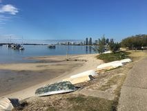 Row Boats on the sand bay side. Beach bay GoldCoast row boats Stock Images