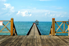 Beach bay. Beach pavilion with wooden bridge Royalty Free Stock Photos