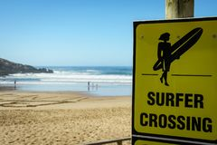 Surfer Crossing Sign South Africa. Beach Bay South Africa sand Surfer Surfing Sport Sea Ocean stock photo