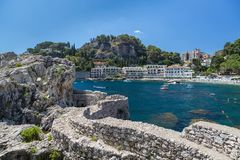 The beach and bay in Taormina in Sicily stock image