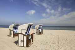 Beach with beach chairs Stock Images