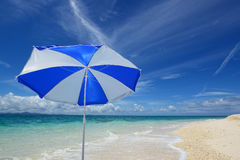 The beach and the beach umbrella of midsummer. Royalty Free Stock Photography