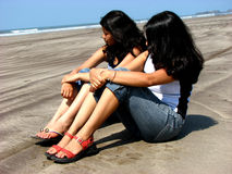 Beach Beauties. TWo beautiful Indian ladies on a beach Royalty Free Stock Image
