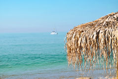 Parasol on the coast. Beautiful, palm beach  umbrellas at the beach Stock Images