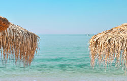 Beach umbrellas. Palm beach  umbrellas at the beach Stock Images
