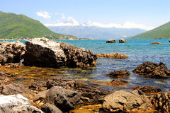 Beach with beautiful, picturesque rocks in the sea and mountains, Herceg Novi , Montenegro, Bay of Kotor. Royalty Free Stock Image