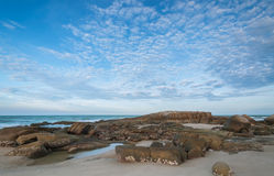Beach with beautiful sky. Rocks on the beach with beautiful sky Royalty Free Stock Photography