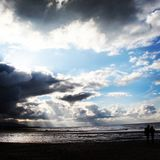 On the beach. Beautiful sky and sun beams shining on the beach Stock Photography