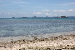 Beach beauty and blue sky. On vacation at the bright sky Beachside Chonburi, Thailand stock photography