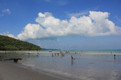 Beach beauty and blue sky. On vacation at the sky Overseas visitors came to rest on the beach. At Chonburi, Thailand Royalty Free Stock Images