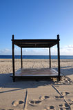 Beach Bed. Bed frame on the beach in Cabo San Lucas, Baja California, Mexico Royalty Free Stock Photo