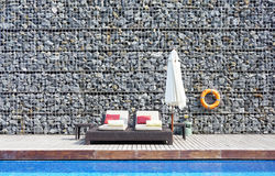Beach bed with rock wall background Stock Image