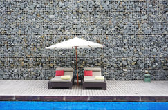 Beach bed with rock wall background Stock Photography