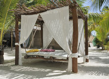 Beach bed on white sand Royalty Free Stock Photography