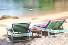 Beach bed on white sand beach at tropical island stock photo