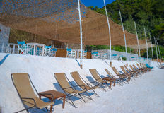 Beach beds at crystal sand of white marble Royalty Free Stock Images
