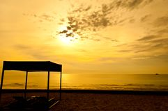 Beach beds and tent at colorful dawn Stock Images