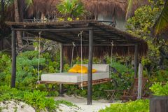 Beach beds among the trees at tropical exotic Stock Image