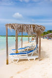 Beach beds and umbrellas at the beach in Cuba Royalty Free Stock Images
