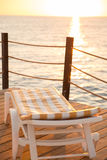 Beach beds at wooden pier Royalty Free Stock Image