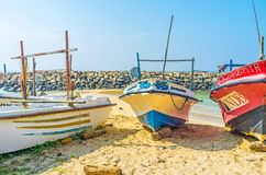 The beach behind the boats Royalty Free Stock Photos