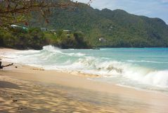 Unseasonal waves crashing against the shore in admiralty bay, bequia Royalty Free Stock Photo