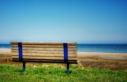 Beach Bench. A lonely bench enjoying the view of a Lake Huron beach Stock Image