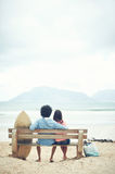 Beach bench couple Royalty Free Stock Image