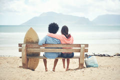 Beach bench couple Stock Images