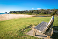 Beach bench. Solid timber bench with outlook to sea Stock Photo