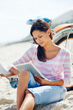Beach bicycle tablet woman Stock Photography