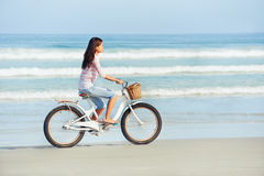 Beach bicycle woman Royalty Free Stock Images