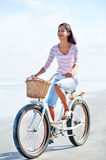 Beach bicycle woman Stock Photos