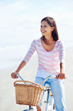 Beach bicycle woman Stock Images