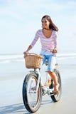 Beach bicycle woman Stock Photos