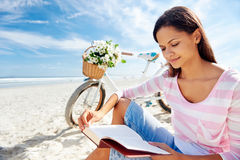 Beach bicycle woman reading book Royalty Free Stock Images