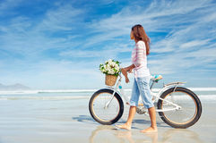 Beach bicycle  woman Royalty Free Stock Image