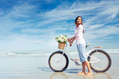 Beach bicycle  woman Royalty Free Stock Photography